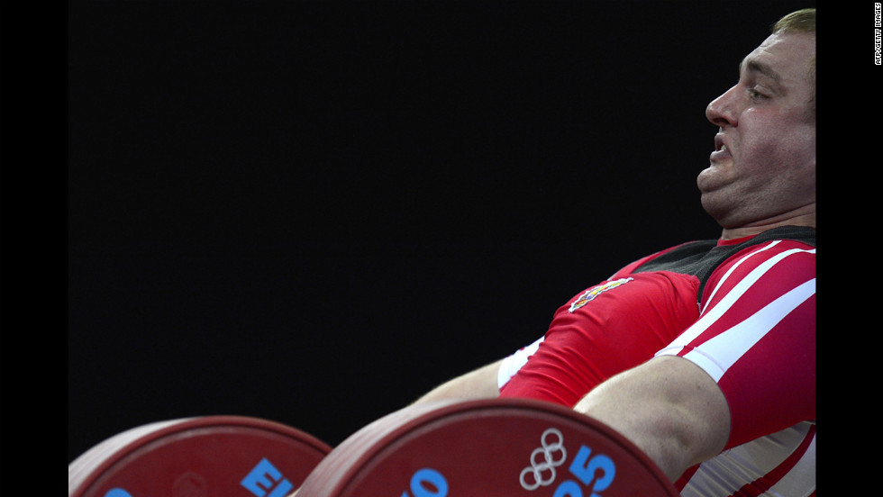 Belarus' Yauheni Zharnasek lifts during the men's +105-kilogram Group B weightlifting event.