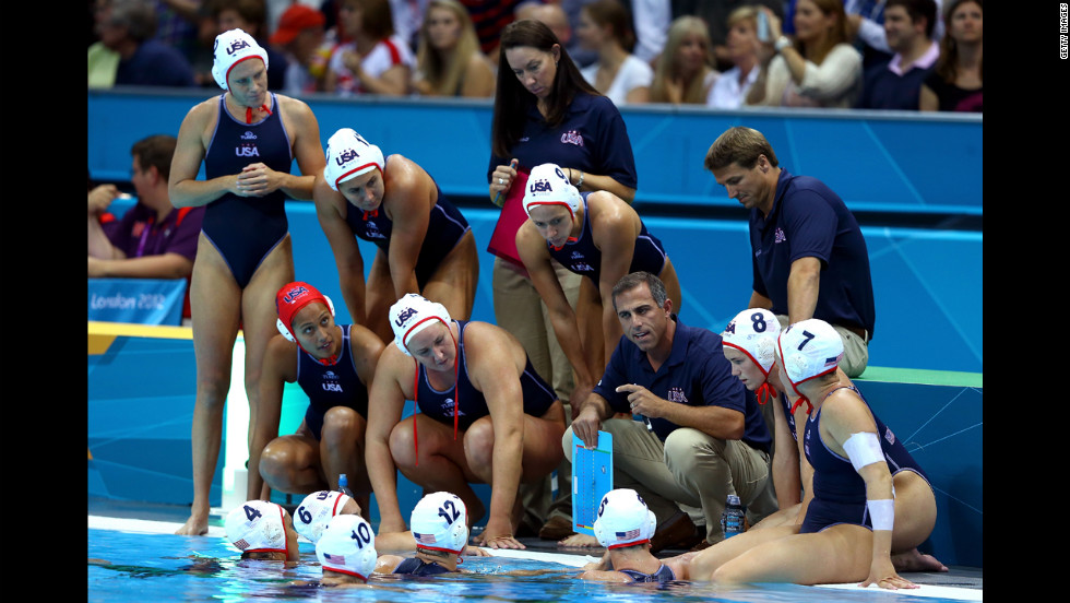 United States water polo coach Adam Krikorian talks with his players during the women's semifinal match against Australia.