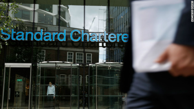 British MPs have criticized U.S. regulators after an assault on Standard Chartered