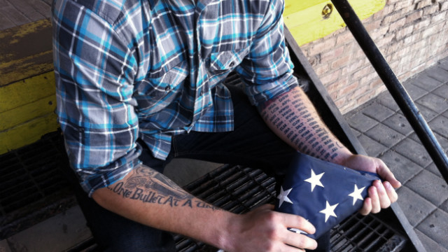 Robert Kyle has tattoos of friends' initials who were killed while deployed. He now works as a peer coach at Vets Prevail.