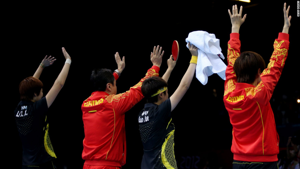 British gangsters (not shown) rob the Chinese table tennis team at gunpoint.