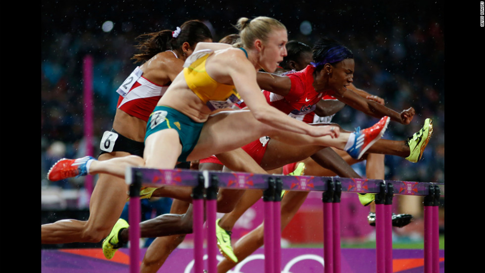Sally Pearson of Australia leads Nevin Yanit of Turkey and Kellie Wells of the United States during the women's 100-meter hurdles final.