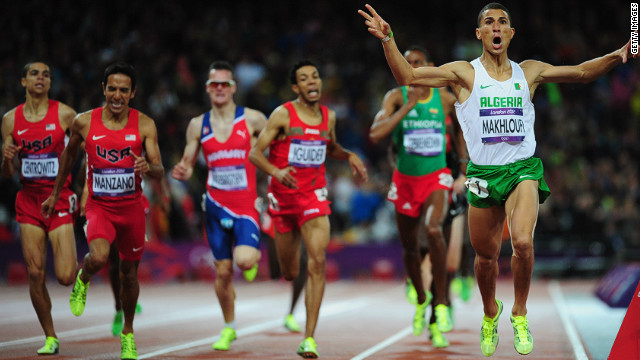 Algeria's Taoufik Makhloufi crosses the line to win gold in 1500m after being reinstated to the Games