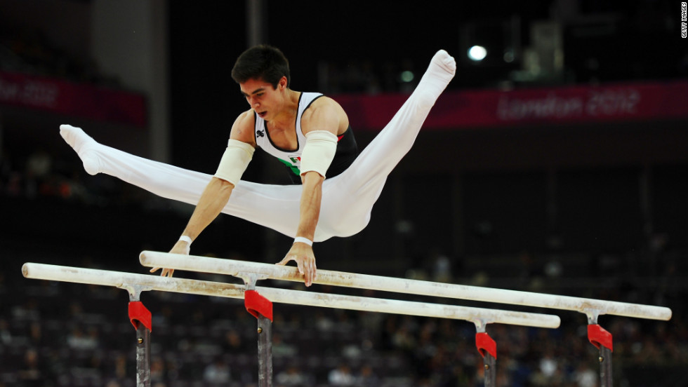 Daniel Corral Barron of Mexico competes in the men's parallel bars final.