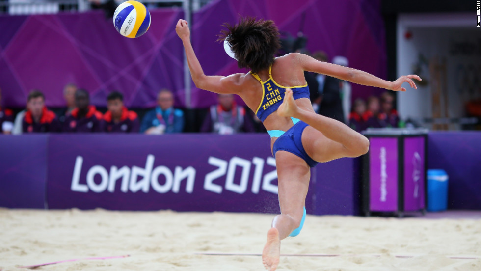 Xi Zhang of China dives for the ball during the women's beach volleyball semifinal match between United States and China.