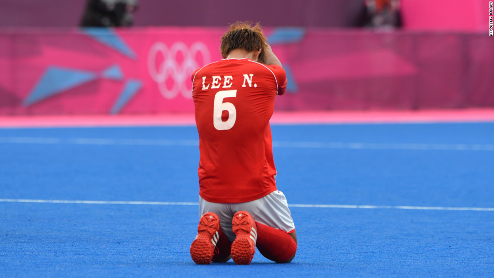 Lee Nam-Yong of South Korea reacts after losing the men's field hockey preliminary round match against Netherlands.