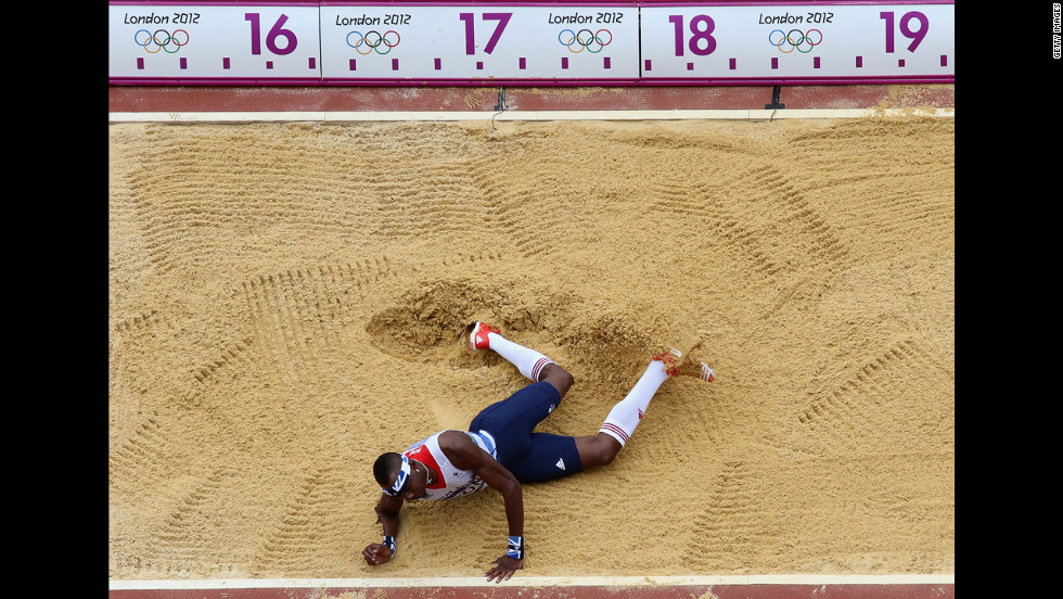 "Phillips Idowu of Great Britain competes in the men's triple jump qualification. Check out photos from <a href=""http://www.cnn.com/2012/08/08/worldsport/gallery/olympics-day-twelve/index.html"" target=""_blank"">Day 12 of the competition</a> from Wednesday, August 8."