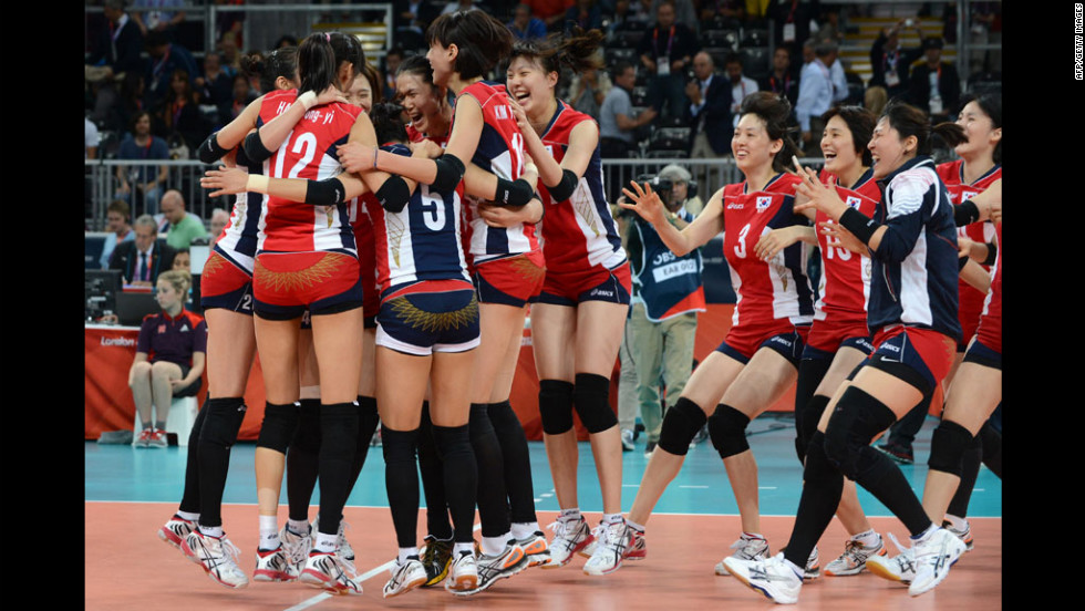 South Korea's players celebrate their victory in the women's quarterfinal volleyball match between Italy and South Korea.