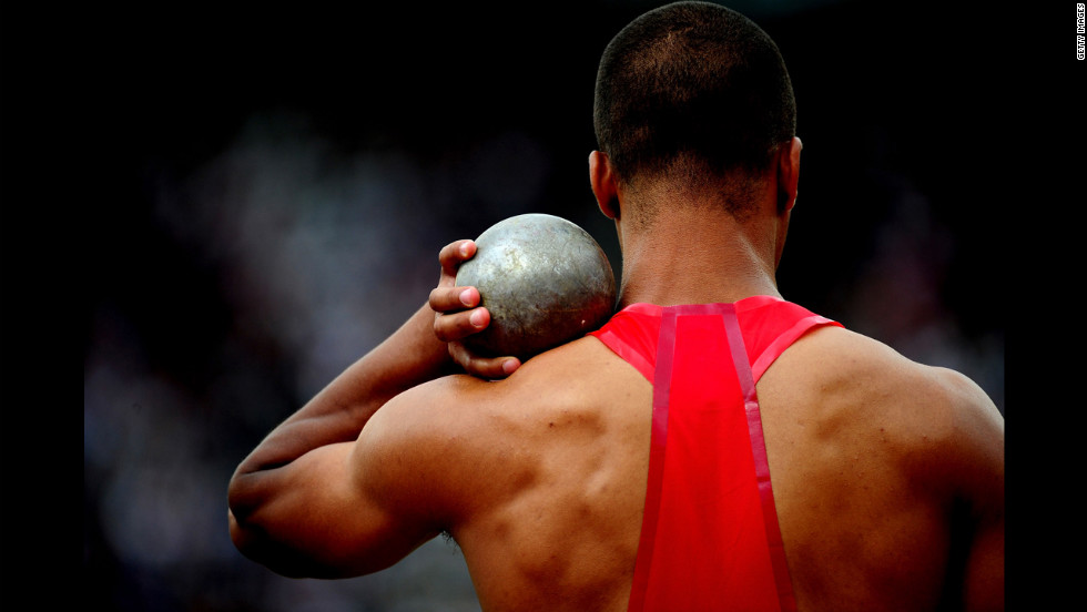 Ashton Eaton of the United States competes in the men's decathlon shot put.