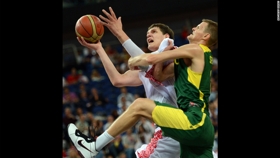 Russian center Timofey Mozgov, left, is challenged by Lithuanian guard Renaldas Seibutis during the men's quarterfinal basketball match.
