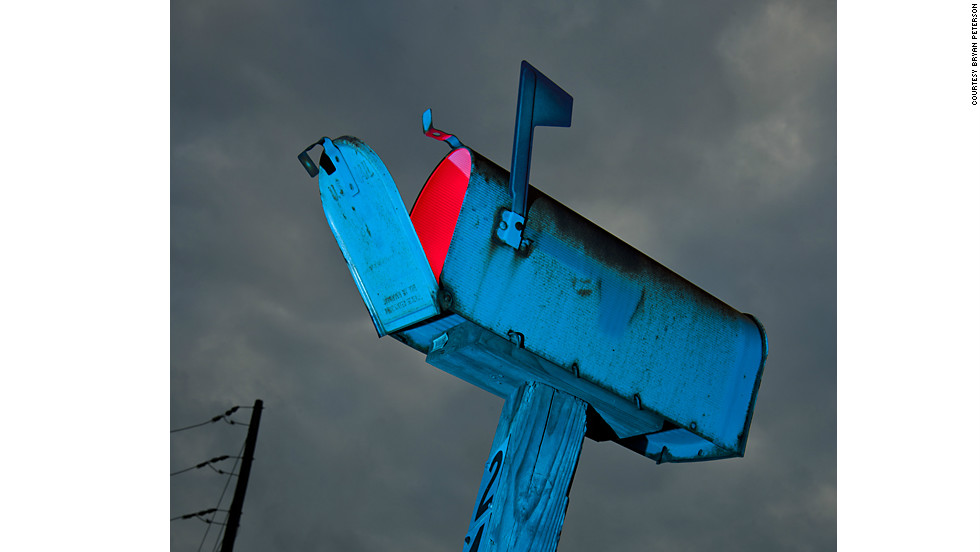 By placing a red light source in this mailbox, Peterson transformed what would have been a normal street scene into a menacing mystery and storytelling image.