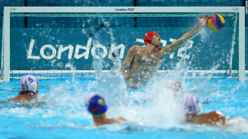 Spain's Blai Mallarach Guell, center, makes a save in the men's water polo quarterfinal match against Montenegro.