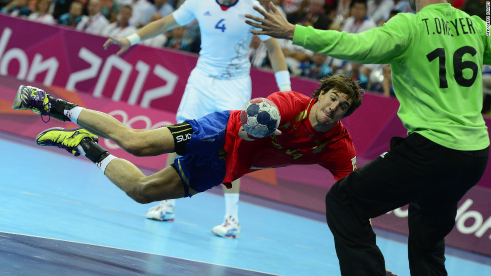 Spain's Albert Rocas Comas shoots during the men's quarterfinal handball match against France.