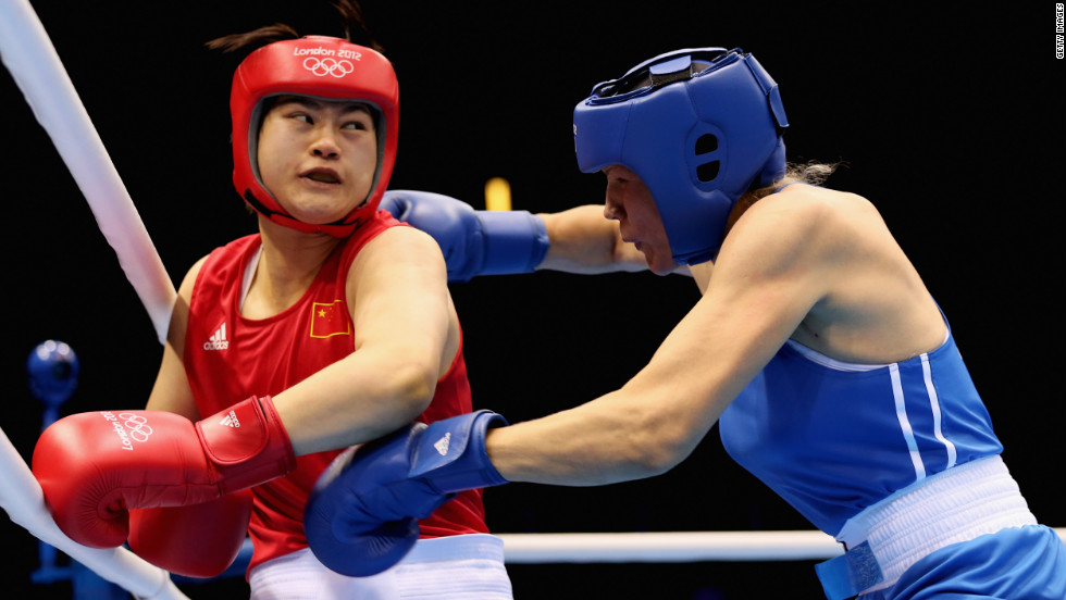 Jinzi Li, left, of China battles Nadezda Torlopova of Russia during the women's middle 75-kilogram boxing semifinals.
