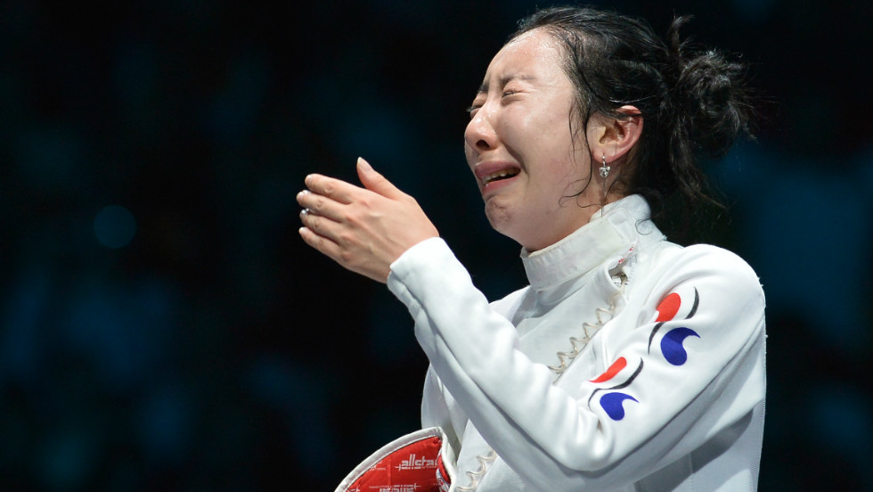 South Korea's Shin A-Lam gets emotional while awaiting the outcome of an appeal over a technical fault during her Women's Epee semifinal bout against Germany's Britta Heidemann.