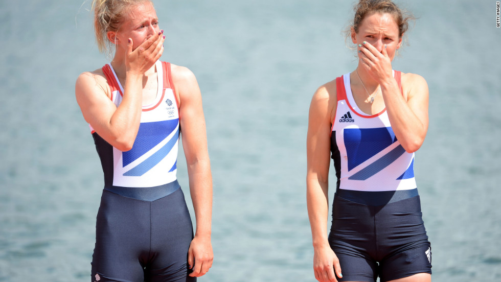 Katherine Copeland and Sophie Hosking of Great Britain cry before receiving their gold medals for the lightweight women's double sculls.