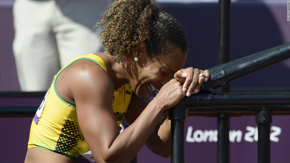 Jamaica's Brigitte Foster-Hylton cries after sustaining an injury running the women's 100-meter hurdles.