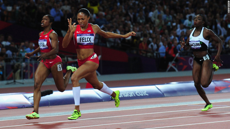Allyson Felix of the United States crosses the finish line ahead of Murielle Ahoure of Cote d'Ivoire and Carmelita Jeter of the United States to win the women's 200-meter final.