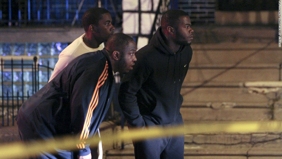 Late on a Sunday night in March, stunned onlookers watch Philadelphia police investigate the city's 60th homicide of 2012, a double shooting inside a car.