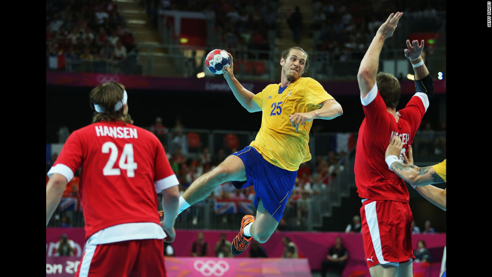 Kim Ekdahl du Rietz of Sweden goes up to shoot against Denmark during the men's quarterfinal match.