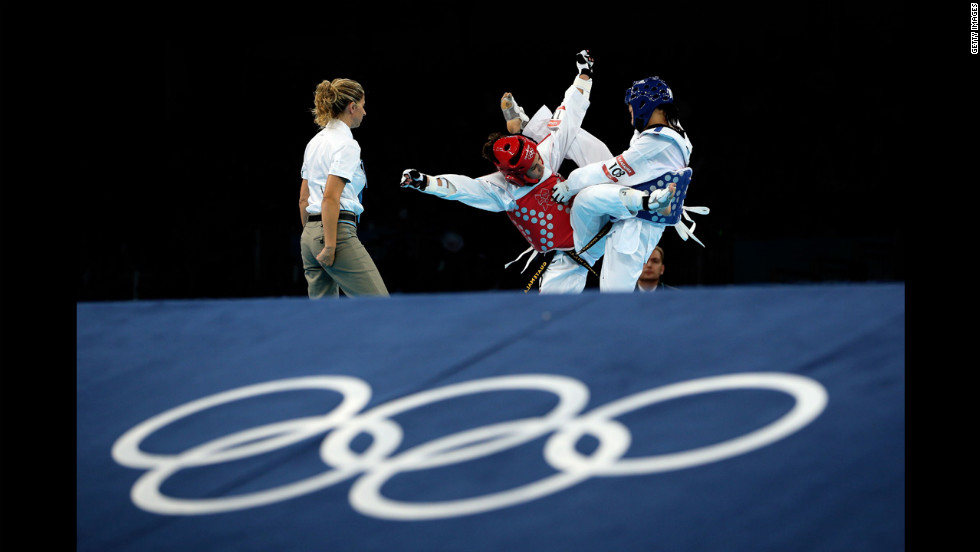 Erika Kasahara of Japan, right, competes against Elizabeth Zamora Gordillo of Guatemala during the women's -49kg taekwondo repechage match.