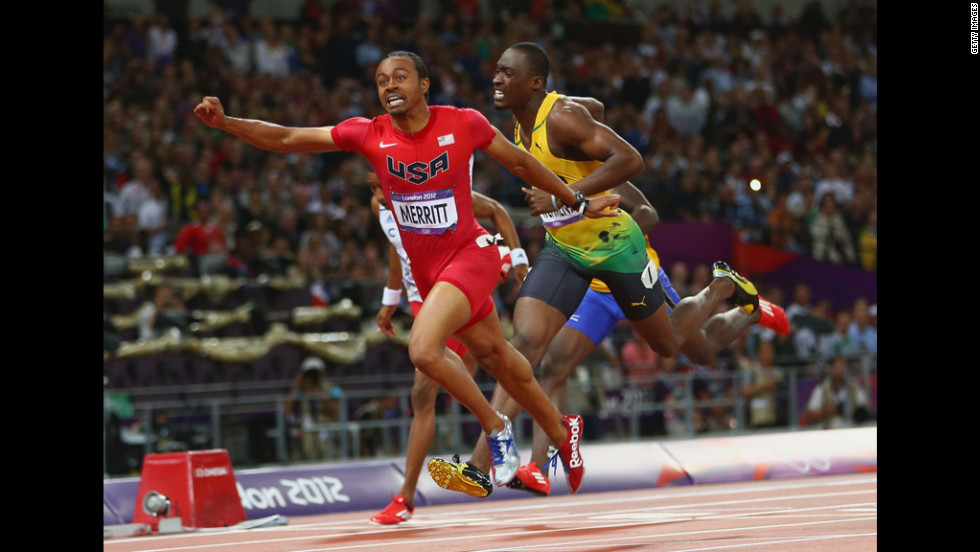 Aries Merritt of the United States crosses the finish line ahead of Hansle Parchment of Jamaica to win gold in the men's 110-meter hurdles final.