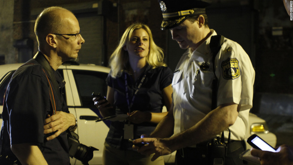 "In March, photojournalist Joe ""Kaz"" Kaczmarek, left, co-founded GunCrisis.org, an open-source interactive journalism project aimed at fighting Philadelphia's growing plague of gun violence. The idea is to shake things up -- and interrupt the violence -- by chronicling the daily gunfire. Kaz spends many nights photographing crime scenes."