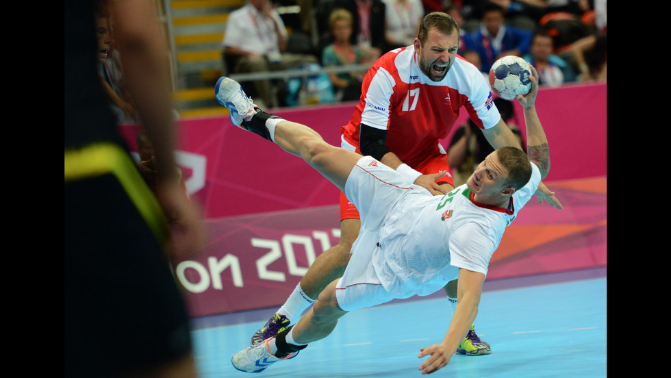 Iceland's Sverre Jakobsson, top, vies with Hungary's Szabolcs Zubai during the men's quarterfinal handball match.