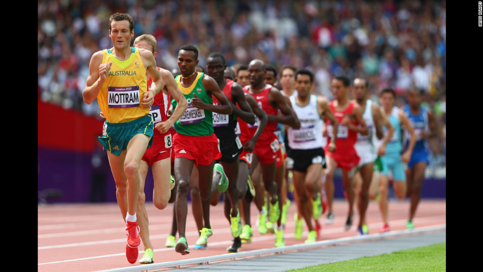 Australia's Craig Mottram leads in round one of the men's 5,000-meter heats at Olympic Stadium.