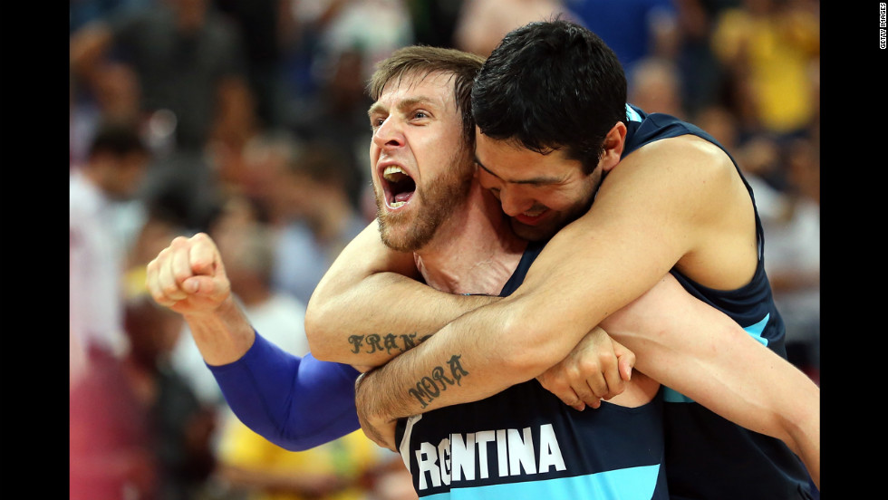 Andres Nocioni, No.13, and Martin Leiva, No.12, of Argentina celebrate Argentina's 82-77 victory against Brazil during the men's basketball quarterfinal.