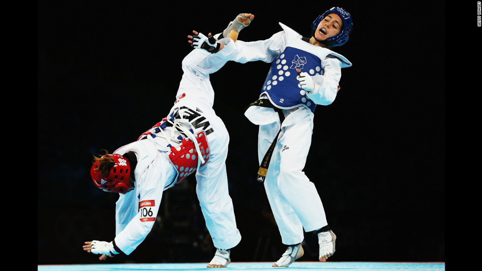 Mexico's Jannet Alegria Pena, left, competes against Raya Hatahet of Jordan during the women's taekwondo under 49-kilogram preliminary round.