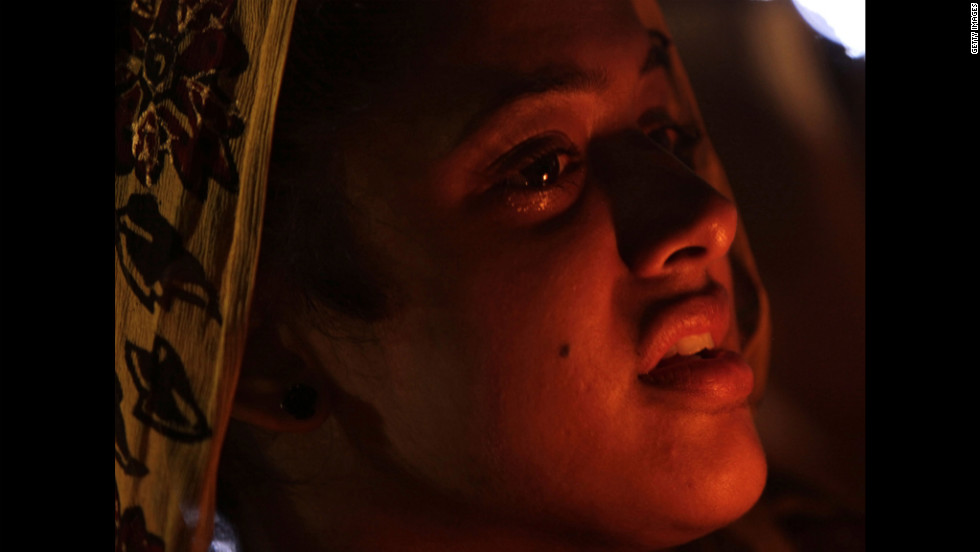 A woman from the Sikh Temple of Wisconsin mourns during a candlelight vigil Tuesday, August 7, at the Oak Creek Community Center in Oak Creek, Wisconsin.