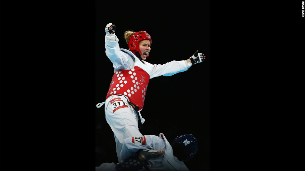 Finland's Suvi Mikkonen, left, spars with Senegal's Bineta Diedhiou during the preliminary round women's under 57-kilogram taekwondo match.