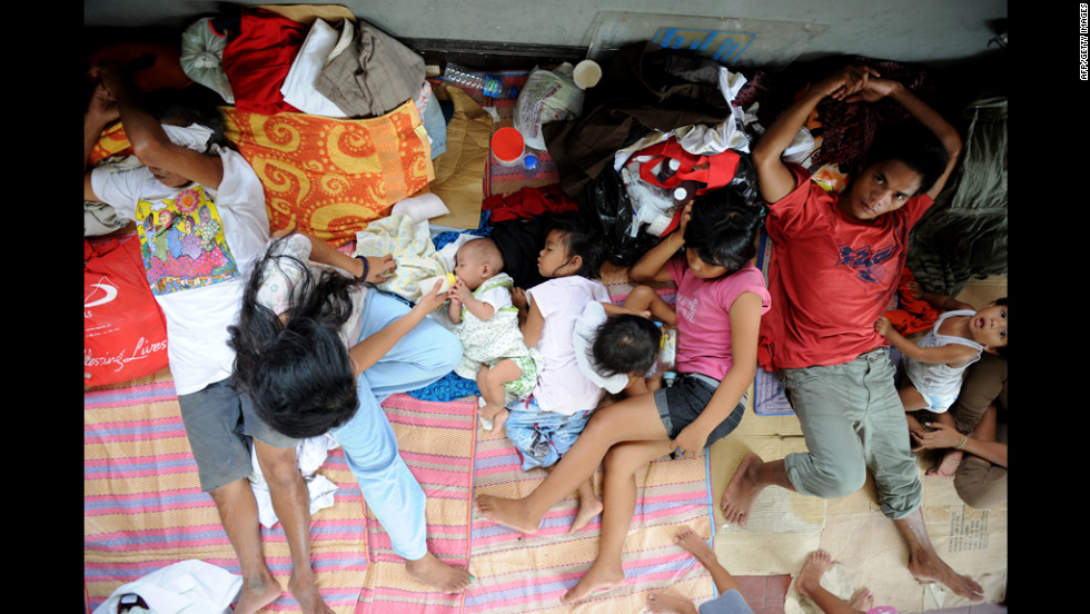 Flood victims take shelter in a church used as an evacuation center in Quezon City, suburban Manila.