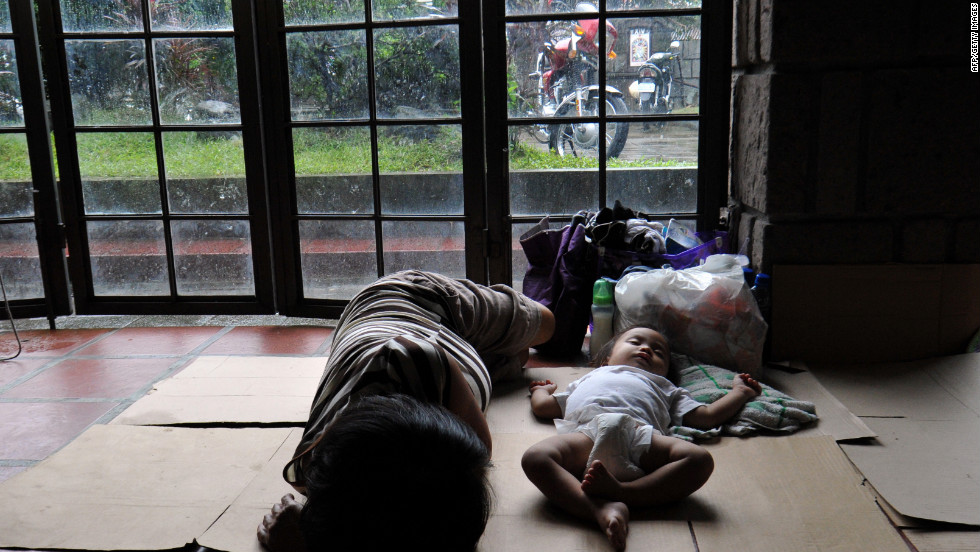 Displaced residents rest at an evacuation center inside a church in suburban Manila.
