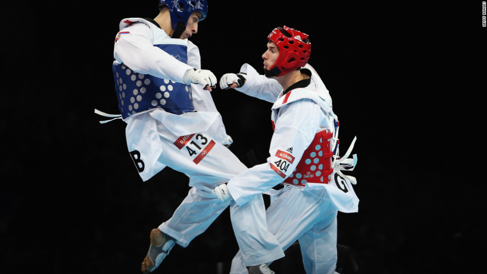 Great Britain's Martin Stamper, right, spars with Serbia's Damir Fejzic in the men's under-68-kilogram taekwondo quarterfinal match.