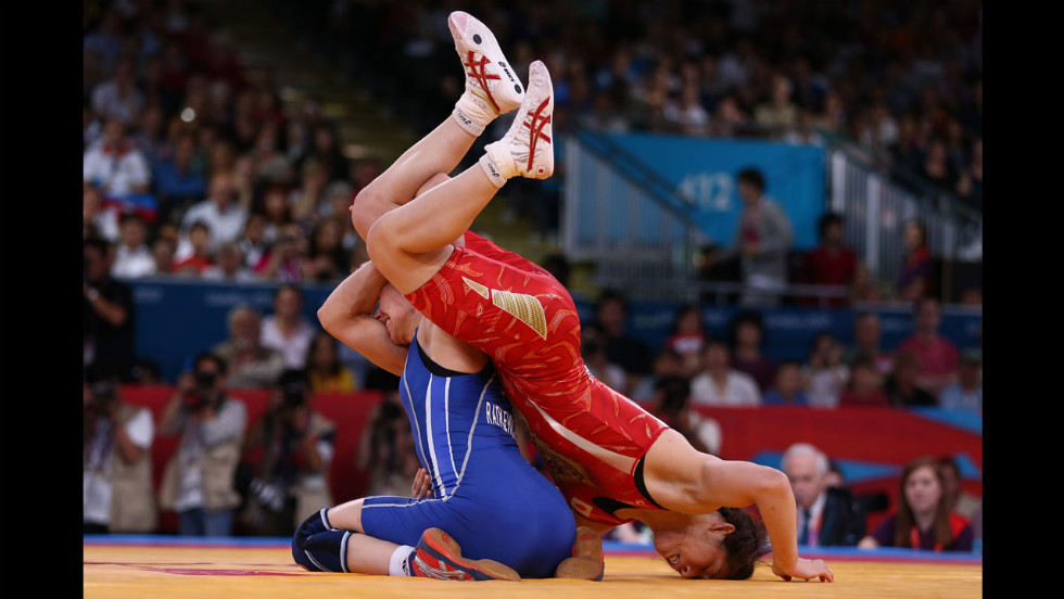 Japan's Saori Yoshida, right, and Azerbaijan's Yuliya Ratkevich compete in the women's freestyle 55-kilogram wrestling.