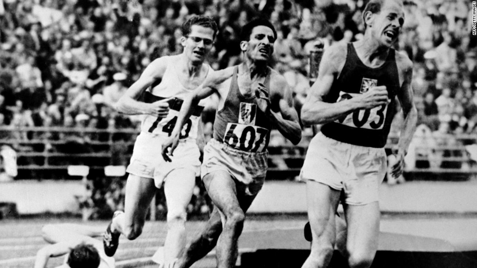 Zatopek sprints to 5,000m gold in Helsinki from Alain Mimoun (France) and Herbert Schade (Germany) with Britain's Chris Chataway falling on the final bend. He also won the 10,000m and marathon -- a feat never repeated.