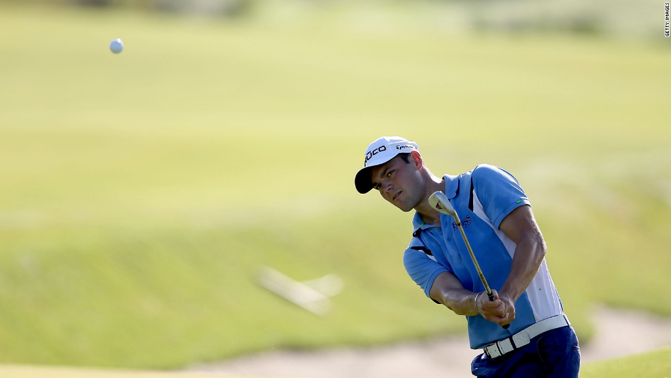 Kaymer hits a shot on the 11th hole.