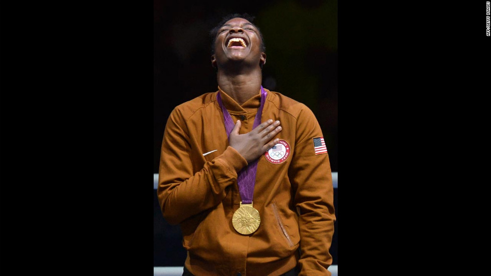 Shields laughs on the podum after receiving her gold medal.