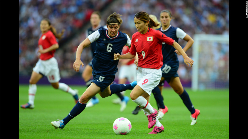U.S. defender Amy LePeilbet, left, fights for the ball with Japanese midfielder Nahomi Kawasumi during the final of the women's football competition.
