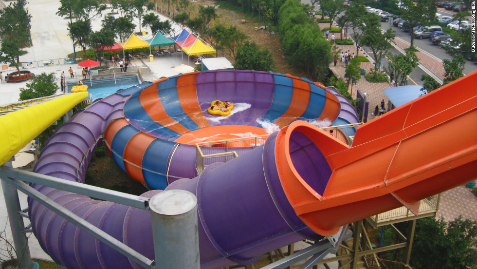 Seated face-to-face on four-person rafts, riders of Behemoth Bowl reach speeds of 32 feet per second as they plummet down a 262-foot-long translucent tunnel and into a 60-foot-wide bowl.