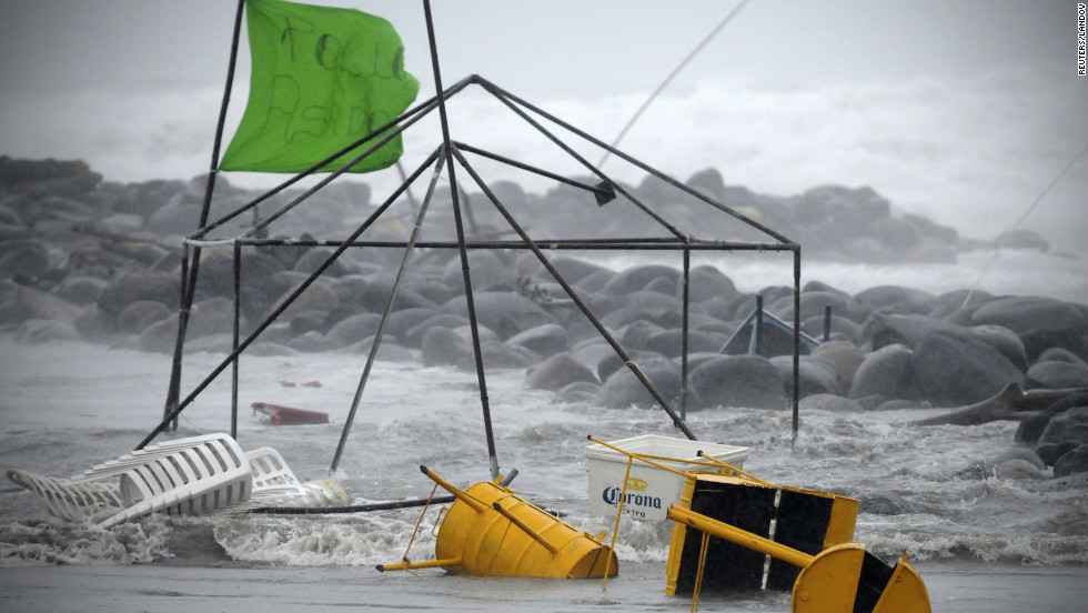 The swelling ocean takes a food stand in Boca Del Rio.