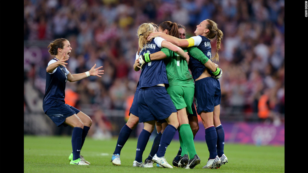 The United States women's soccer team begins the celebration after defeating Japan, avenging its 2011 World Cup final loss.
