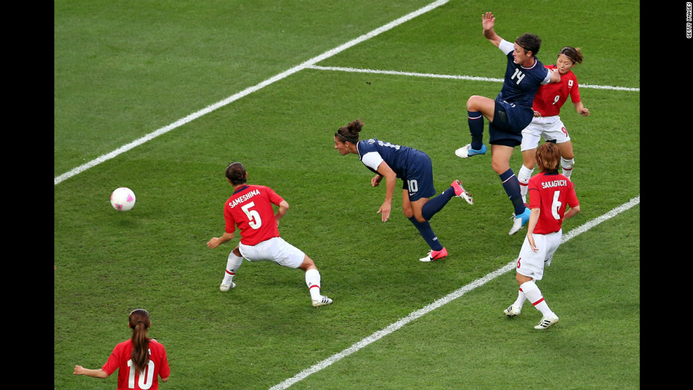 Midfielder Carli Lloyd of the United States heads in a goal in the first half of the game against Japan. The U.S. women's soccer team took its third straight Olympic gold medal.