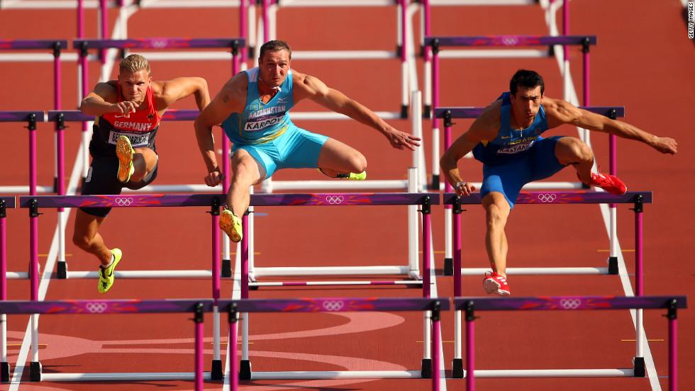 From left, Pascal Behrenbruch of Germany, Dmitriy Karpov of Kazakhstan and Oleksiy Kasyanov of Ukraine race during the men's decathlon 110-meter hurdles heats.