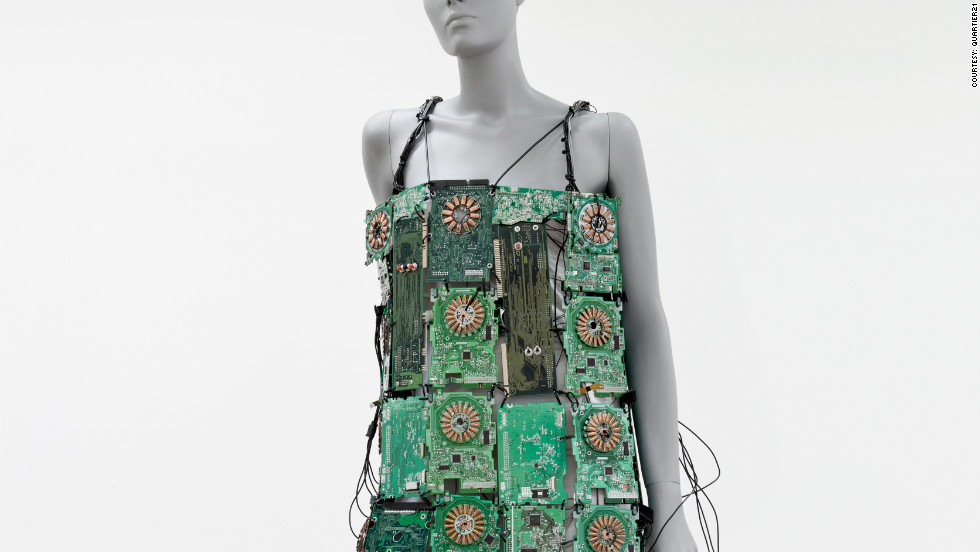This wearable musical instrument is made from 35 circuit boards. It incorporates 12 coils, which create sounds when connected through copper plates on the wearer's fingers. The battery-powered dress includes two speakers.