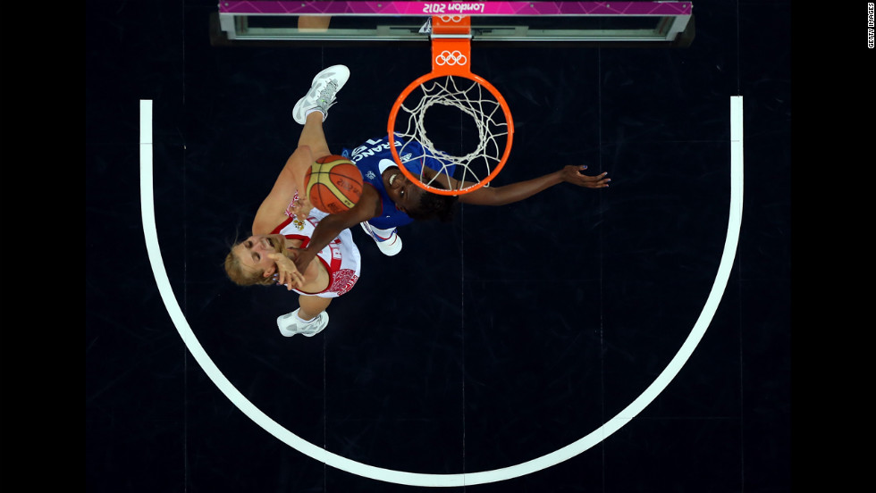Natalia Vieru, No.11 of Russia, puts up a shot over Jennifer Digbeu, No.15 of France, during the women's basketball semifinal.