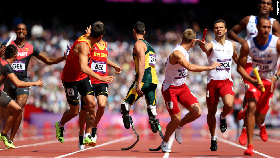 South Africa's Oscar Pistorius, center, waits for the baton during the men's 4 x 400-meter relay round 1 heats. Pistorius made history when he became the first double amputee athlete to compete in the Olympics.