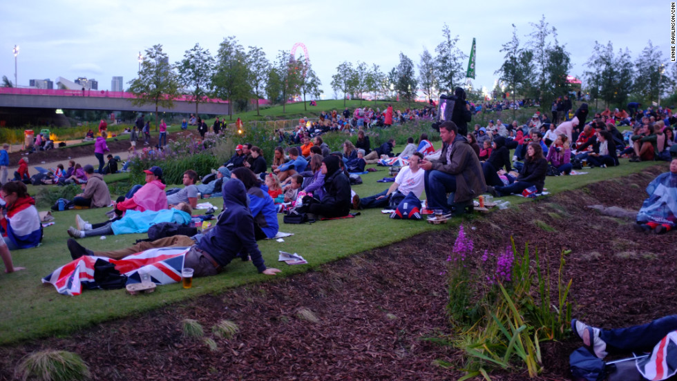 ... watched by many hardy Olympics fans who'd purchased park tickets or stayed on after watching the day's events.